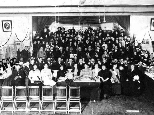 Children of striking textile workers from Lawrence, Mass., are entertained at a banquet at the Socialist Hall in Barre. They were part of the Children's Exodus in 1912 when their families sent them to Barre for their own safety during the Bread and Roses Strike.