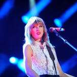 Taylor Swift performs at LP Field for the first nightly concert at the 2013 CMA Music Festival Thursday June 6, 2013, in Nashville, Tenn.