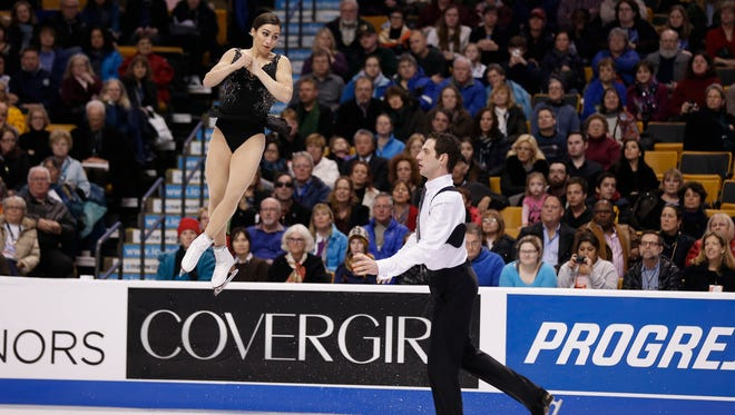 Marissa Castelli and Simon Shnapir perform during the pairs free skate at the U.S. Figure Skating Championships at TD Garden on Saturday.