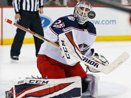 Columbus Blue Jackets goalie Sergei Bobrovsky makes a save against the New Jersey Devils during the second period of an NHL hockey game, Friday, Dec. 8, 2017, in Newark, N.J.