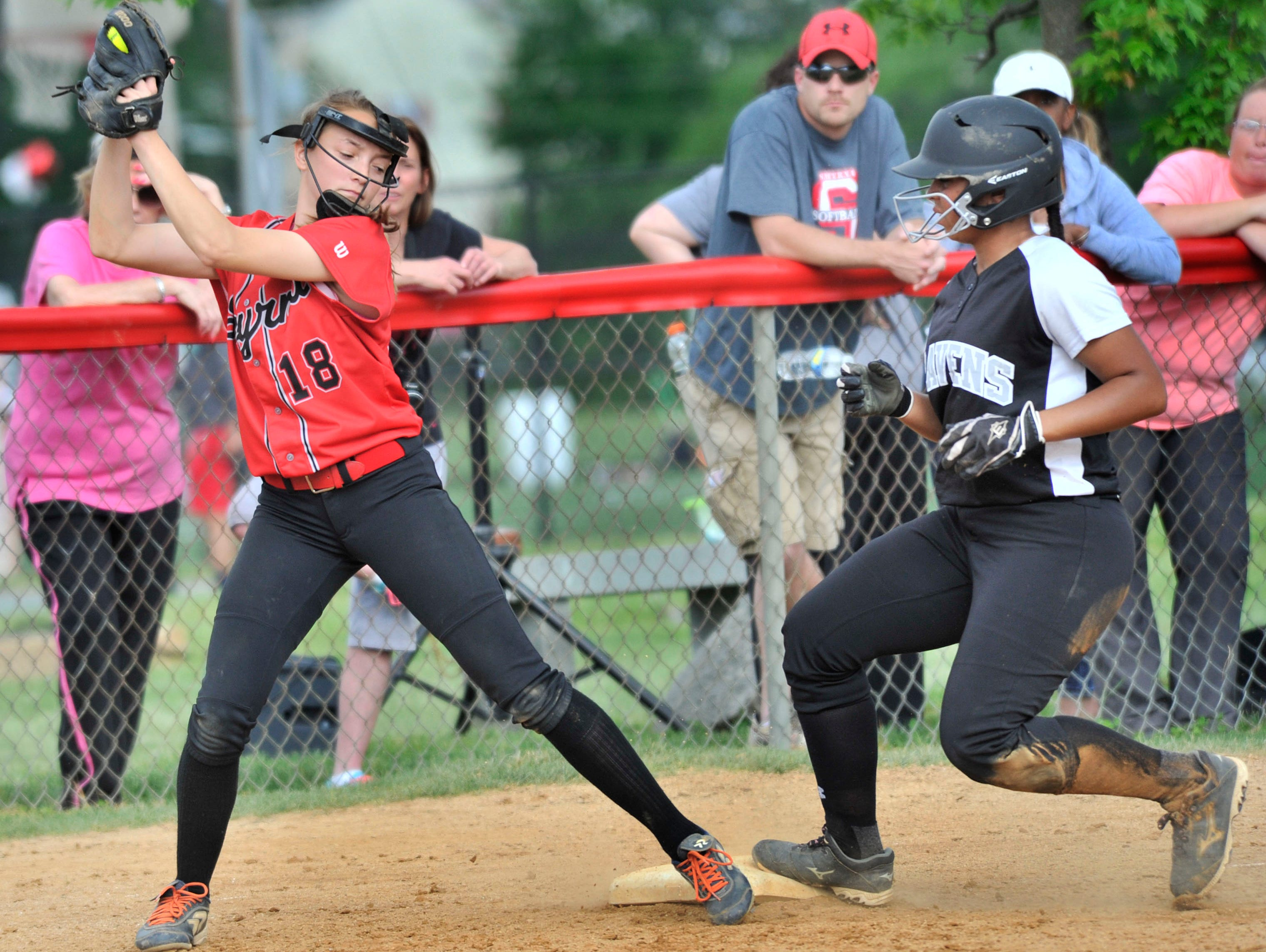 Sussex Tech's Madison Watson moves to third on a wild pitch last Thursday as Smyrna's Sarah Miller snags a late throw. Sussex Tech is ranked No. 2 statewide in softball.