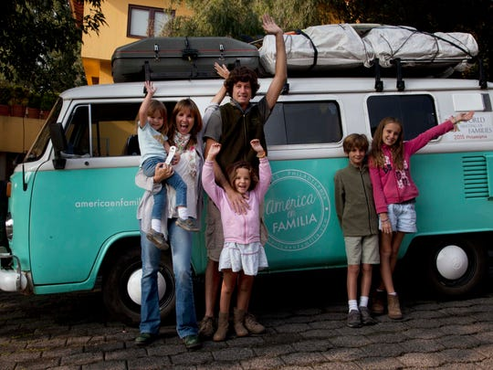 Catire Walker; his wife, Noel; and their four children, Carmin, Mia, Dimas and Cala, pose for a photo in front of their Volkswagen bus in Mexico City on Aug. 22.