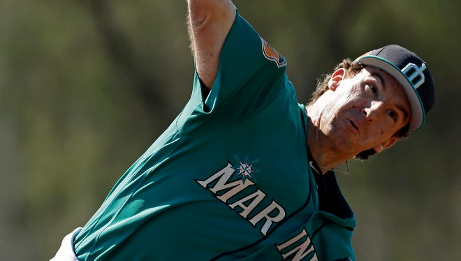 Mariners prospect Andrew Moore throws at spring training earlier this week.