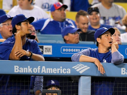 Los Angeles Dodgers' Yu Darvish, left, of Japan, and
