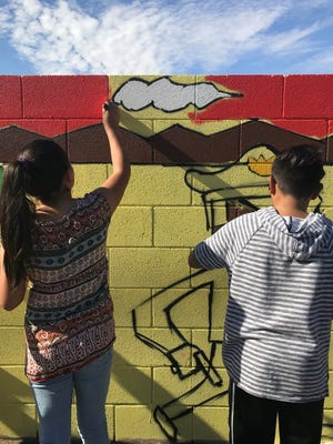 The Maryvale community helped paint the mural, which will work as an educational tool and a way to bring community together.