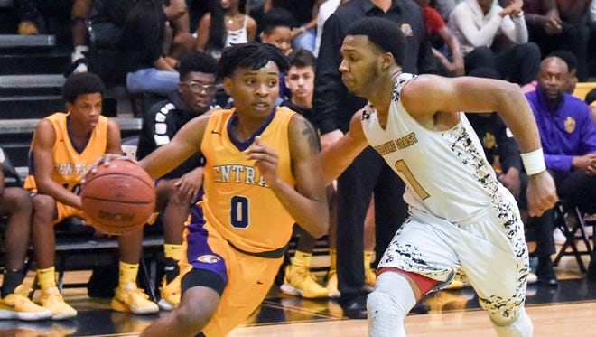 Fort Pierce Central's Reginald Dotson (0) is pressured by Treasure Coast's Chris Brown Tuesday, Jan. 23, 2018, during a high school boys basketball game at Treasure Coast High School.
