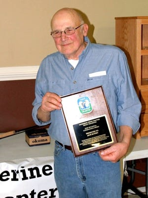 Jack Russen shows off his Trout Unlimited Conservationist of the Year plaque.