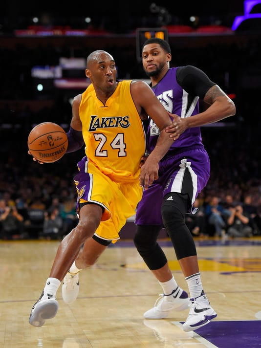 Los Angeles Lakers forward Kobe Bryant, left, drives by Sacramento Kings forward Rudy Gay during the second half of an NBA basketball game Wednesday, Jan. 20, 2016, in Los Angeles. The Kings won 112-93. (AP Photo/Mark J. Terrill)