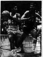 Texas Western's Bobby Hill (14) drives the for the basket but is turned away by Eastern New Mexico's Rodger Hesler in Saturday night's (Dec. 4, 1965) basketball opener at Memorial Gym. The Miners jumped to a quick lead and took an 89-38 victory. Times staff photo
