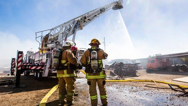 Phoenix firefighters battled a blaze at a scrap yard near Broadway Road and 29th Avenue on Sept. 5, 2016, in Phoenix.