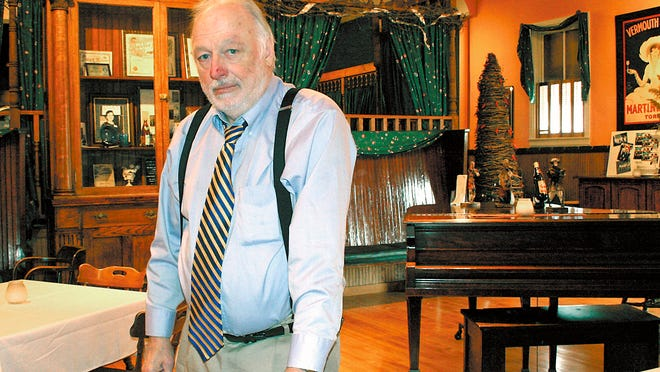 In this 2006 photo, Ron Kaminski stands in the Historic Forst Inn in Tisch Mills, where he founded the Little Sandwich Theatre in 1982.