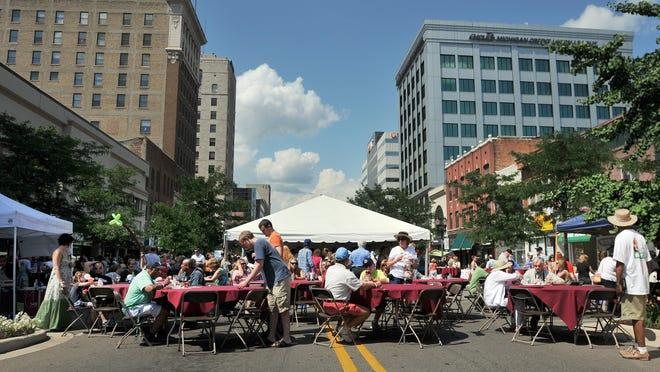 People enjoy A Taste of Downtown in Lansing in 2013.