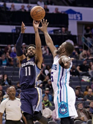Memphis Grizzlies' Mike Conley (11) shoots over Charlotte Hornets' Kemba Walker (15) in the second half of an NBA basketball game in Charlotte, N.C., Monday, Nov. 21, 2016.