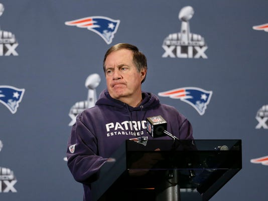 New England Patriots head coach Bill Belichick listens to a question during a news conference Thursday, Jan. 29, 2015, in Chandler, Ariz. The Patriots play the Seattle Seahawks in NFL football Super Bowl XLIX Sunday, Feb. 1. (AP Photo/Mark Humphrey)