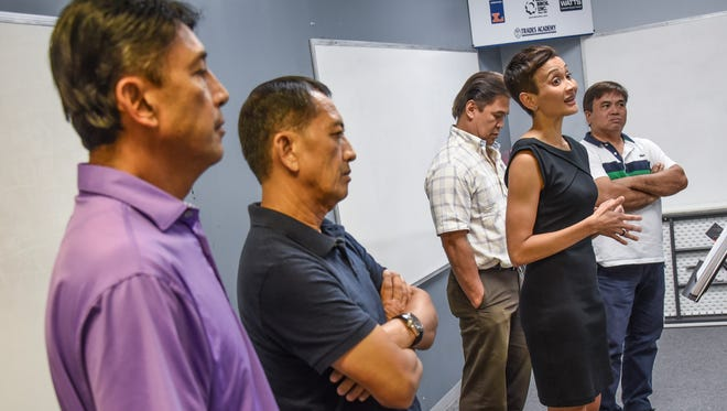 In this Oct. 4, 2016, file photo, attorney Jennifer Davis, front right, is flanked by her firm's clients at a press conference. From left, 5M Construction Corporation Vice Presidents Robert and Larry Manalo, Marianas Linen President Nelson Del Carmen and New Freshbread Bakeshop executive pastry chef Arthur Zantua. The companies filed a lawsuit over the high rejection rate of H-2B visas for Guam businesses.