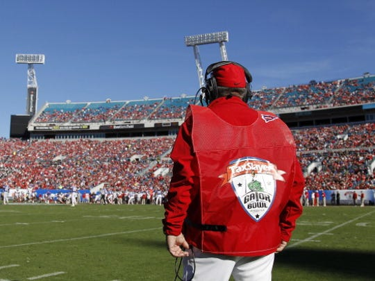 An official watches the field during the 2012 Gator Bowl, between Florida and Ohio State.