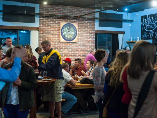 The taproom at the 1st Republic Brewing Company in Essex is full on Friday, November 3, 2017.