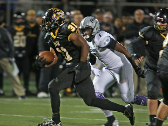 Avon's Bryant Fitzgerald takes off for a touchdown