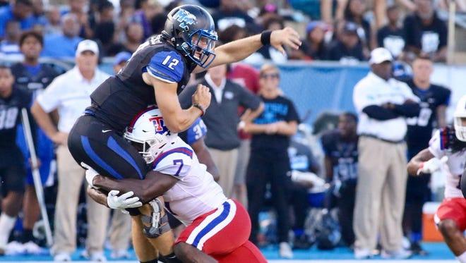 Louisiana Tech safety Xavier Woods hits MTSU quarterback Brent Stockstill in Saturday's 38-34 loss.