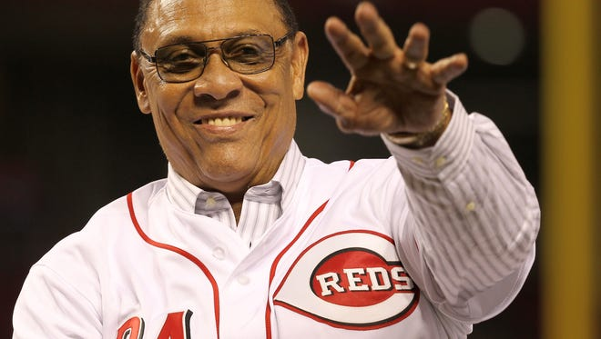 Cincinnati Reds great Tony Perez waves to the crowd during postgame celebrations commemorating Tony Perez weekend, Friday, Aug. 21, 2015, at Great American Ball Park in Cincinnati.