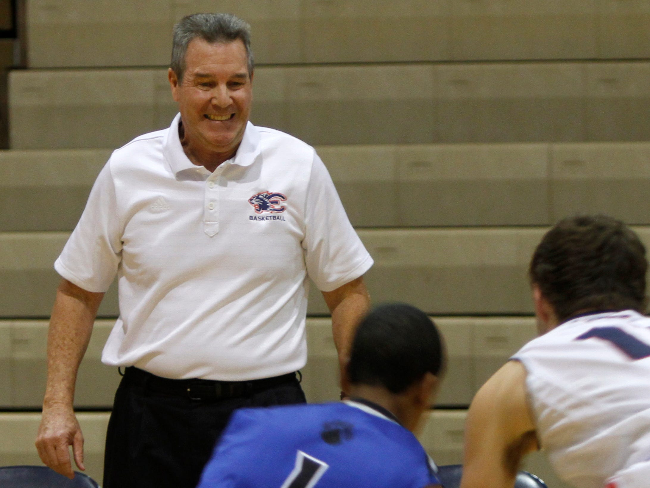 Estero boys basketball coach Lee Peters prepares to jump out of the way when the action gets close against Canterbury Wednesday in Estero.