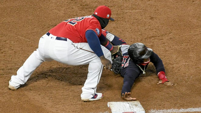 Minnesota Twins first baseman Miguel Sano picks off the Indians' Francisco Lindor as Lindor dives back to first during the sixth inning Friday in Minneapolis.