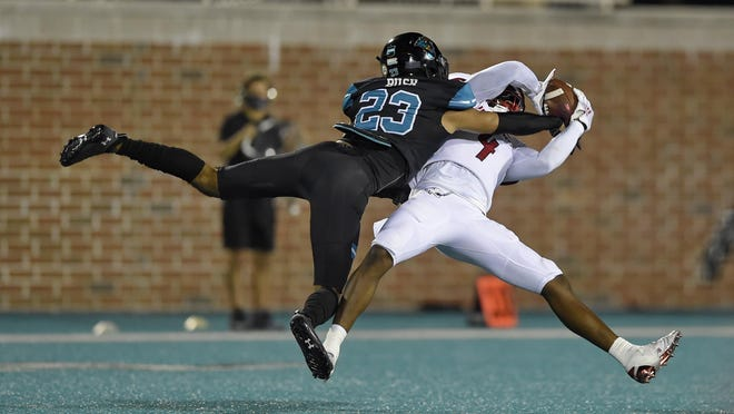 South Alabama's Jalen Wayne (4) catches a pass while defended by Coastal Carolina's Derick Bush during a game Nov. 7 in Conway, S.C. CCU won 23-6.