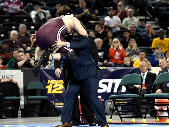 Don Bosco Prep's Peter Acciardi jumps onto his coach