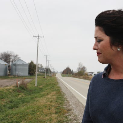 Laura Maurer of Brooklyn, Iowa, looks on with anguish