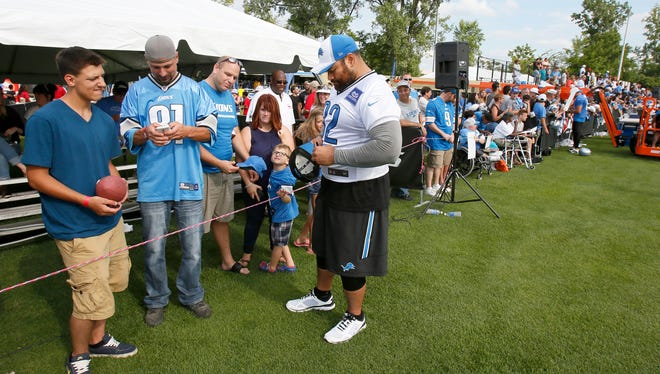 Detroit Lions Haloti Ngata, who is one the Active/Non-Injury list, signs autographs for fans after the Tam's practice on Friday, August 7, 2015, in Allen Park.