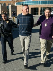 Stephen Siddall is arrested by Las Cruces Police Department Detective Robert Campos, right, and LCPD officer Veronica De La O on Monday at 3rd Judicial District Court. Siddall is accused of embezzling nearly $200,000 from state Sen. Mary Kay Papen.