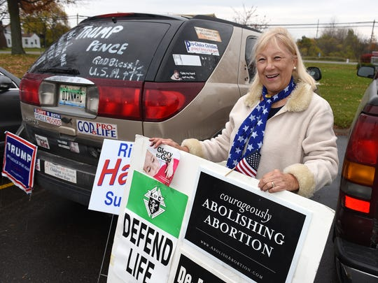 Delores Salvia stands outsitde Highland Township's Apollo Center on voting day greeting people with her support of Donald Trump and pro-life. Salvia's husband Joe Salvia is running for township trustee.