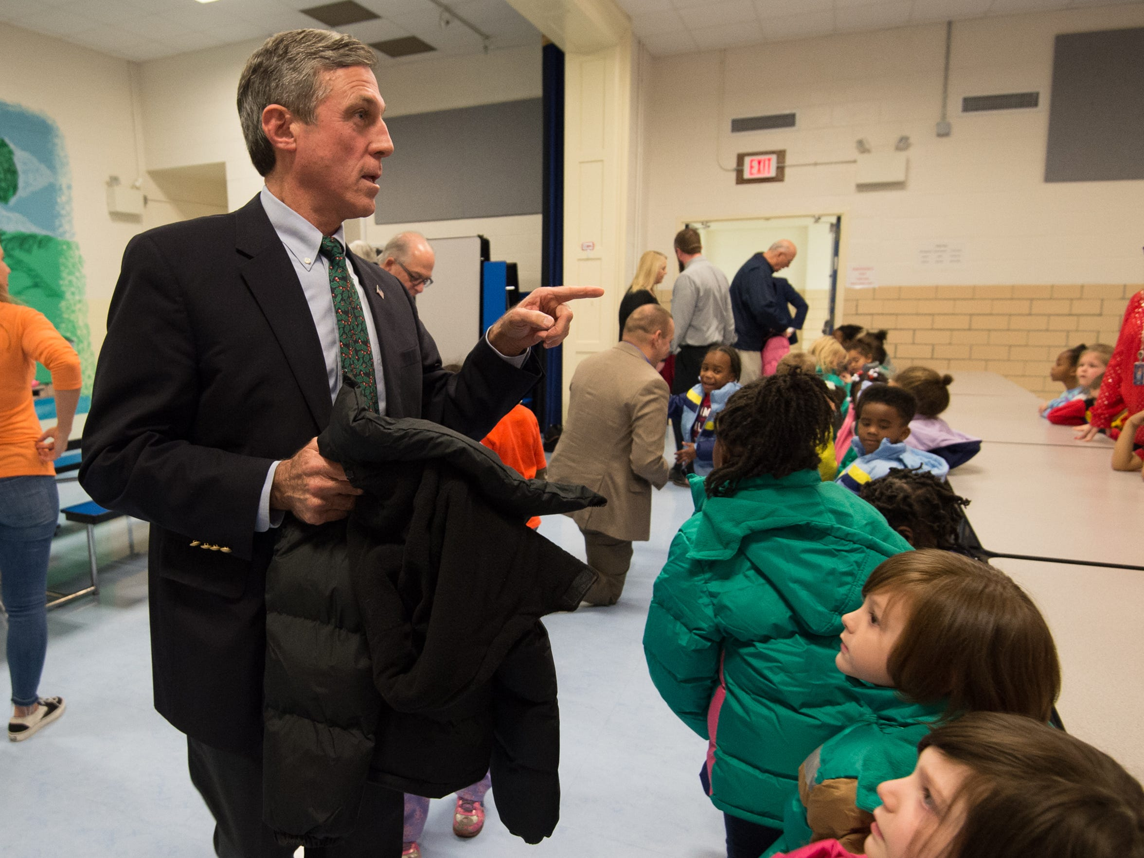 Governor John Carney helps hand out winter coats at West Seaford Elementary School.