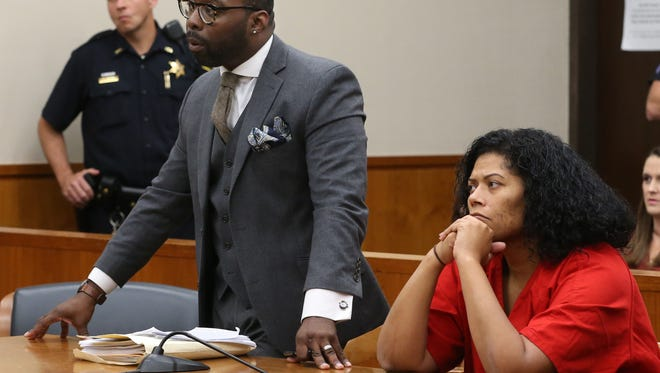 Rochester City Court Judge Leticia Astacio with her lawyer, Gregory Salmon, left, during her bail application hearing Wednesday, Oct. 25, 2017 at the Hall of Justice in Rochester.