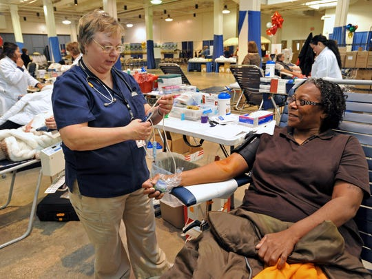 Phlebotomist Gwen Tarr prepares to draw blood from donor Mary Baine of Snow Hill at last year's Beach Blanket Blood Drive, OC Cares, at the Ocean City convention center. The event returns to the convention center on Jan. 21.