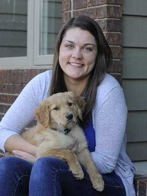 Washington's Caryn Hazard with her golden retriever, Stella, at her home in Sioux Falls.  Hazard will attend South Dakota School of Mines and Technology to be a veterinarian.