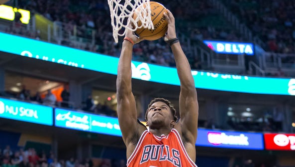 Jimmy Butler throwing down a two-handed dunk.