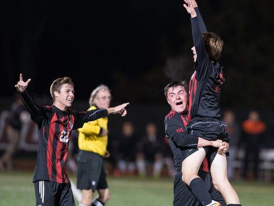 Members of Bennett's celebrate after scoring a goal