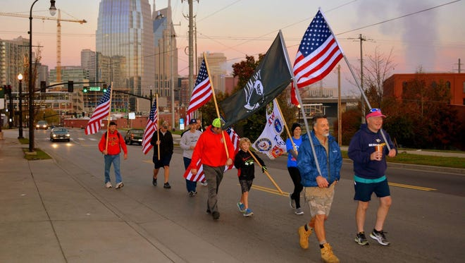 Jim Retzke, front left, leads a group last year in his annual 32-mile Fallen Soldiers March from Nashville to Lebanon. Gerry O'Hanlon, front right, is next to Retzke. In the second row are Brad Forrest, left, Cooper Wright and Brooke Haley-Means. Cooper's father, Dwayne Wright, is behind him.
