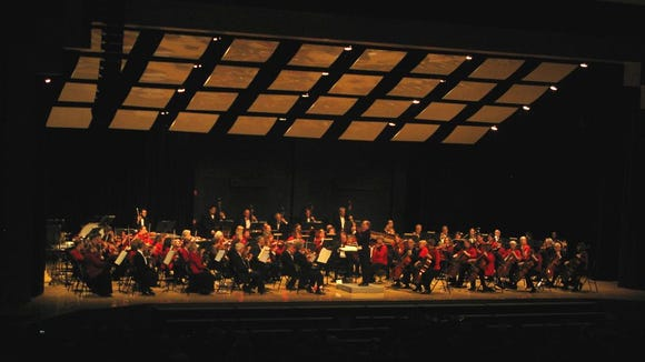 This is David Harman's 14th year as Music Director and Conductor of the Penfield Symphony Orchestra. He is shown here conducting the orchestra for the Holiday Concert.