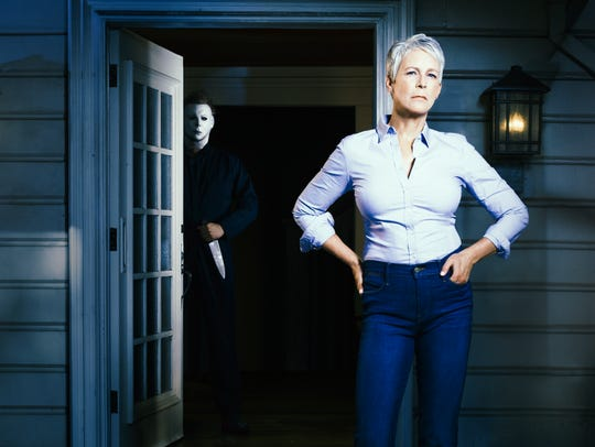 Jamie Lee Curtis and masked villain Michael Myers share