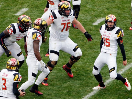 In this Nov. 1, 2014, file photo, Maryland place kicker Brad Craddock (15) celebrates with teammates after kicking a 43-yard, game-winning field goal with 51 seconds left in the second half giving the Terrapins a 20-19 win in an NCAA college football game against Penn State in State College, Pa.
