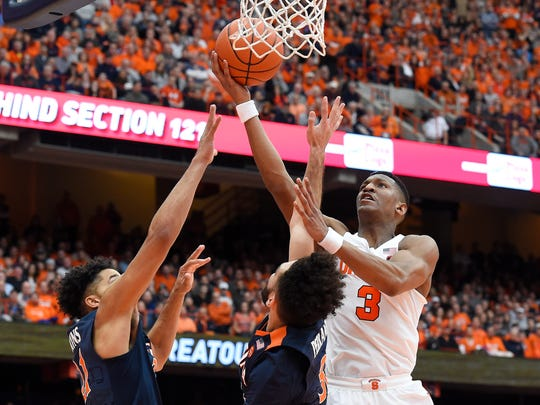 Andrew White III (3) is averaging 25 points and making 48 percent of his shots overall in the Orange's five-game winning streak. His 20.8 scoring average in ACC play tops the conference.