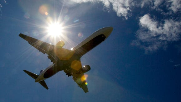 In this July 20, 2009 file photo, a plane flies into