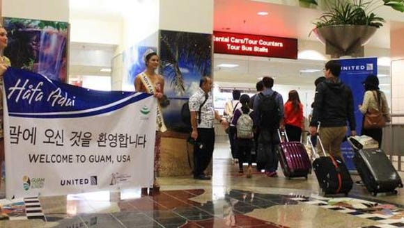 Arriving passengers from UA164 were greeted by, from