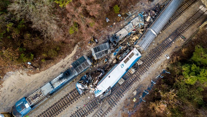 An aerial view of the site of an early morning train crash Feb. 4, 2018, between an Amtrak train, bottom right, and a CSX freight train, top left, in Cayce, SC. The Amtrak passenger train slammed into a freight train in the early morning darkness Sunday, killing two Amtrak crew members and injuring more than 100 people, authorities said.