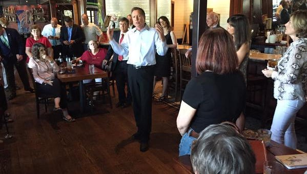 Gov. John Kasich woos possible supporters of his 2016 presidential aspirations in Charleston, South Carolina, in May. Kasich is planning his first visit to Iowa.