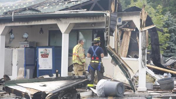 Firefighter at scene of fire at a Byrne Dairy in Phelps Tuesday.