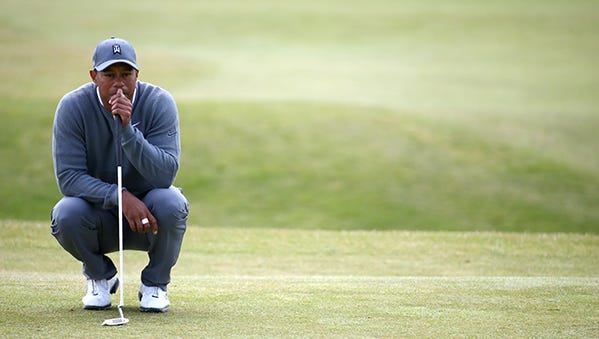 Tiger Woods waits for his turn to play on No. 7 at St. Andrews on Thursday.