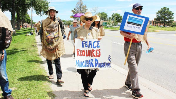 Members of Pax Christi New Mexico walk Trinity Drive toward Los Alamos National Laboratory last year on their march. This will be the 13th year the group has protested.